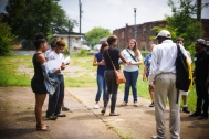 Magaela facilitating a community mapping activity with urban geographer, Dr. David Padgett and youth research collaborators.